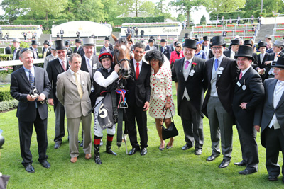 ROYAL ASCOT WED 17 JUNE 2015  PICTURE: CAROLINE NORRIS     FREE EAGLE WITH WHACKER O'BRIEN, MARK AND DERMOT WELD, PAT SMULLEN, CARLOS VIEIRA, FIONA CRAIG, MALACHY RYAN, KRIS WELD AND JOHN OSBORNE AFTER WINNING THE PRINCE OF WALES'S STAKES