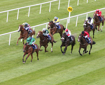 CURRAGH SAT 18 JULY 2015  PICTURE: CAROLINE NORRIS     HAVE A NICE DAY RIDDEN BY PAT SMULLEN WINNING THE KILSARAN INTERNATIONAL HANDICAP FROM CAPTAIN CULLEN RIDDEN BY IAN QUEALLY, 2ND, RED AND WHITE, BREATHE EASY RIDDEN BY LEIGH ROCHE, GREEN AND WHITE, 4TH, AND CREGGS PIPES RIDDEN BY BILLY LEE, 5TH, ON RAIL