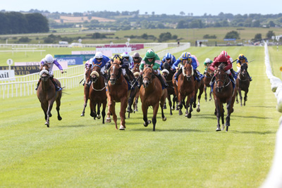 CURRAGH SAT 18 JULY 2015  PICTURE: CAROLINE NORRIS     STROLL PATROL RIDDEN BY ANDREA ATZENI, RIGHT, WINNING THE EVOKE.IE SPRINT FROM YOUR PAL TAL RIDDEN BY DONAGH O'CONNOR, CENTRE, 2ND, AND IN SALUTEM RIDDEN BY CHRIS HAYES, 3RD, LEFT, YELLOW DIAMONDS ON CAP