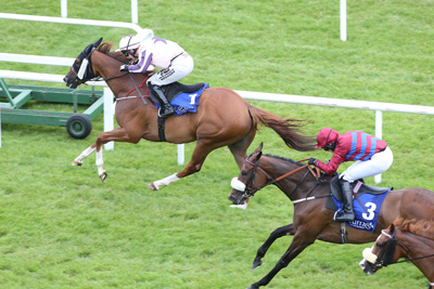 CURRAGH SAT 18 JULY 2015  PICTURE: CAROLINE NORRIS     TOOREEN LEGEND RIDDEN BY NINA CARBERRY WINNING THE BOODLES LADIES DERBY FROM MAJENTA RIDDEN BY JANE MANGAN, 2ND.