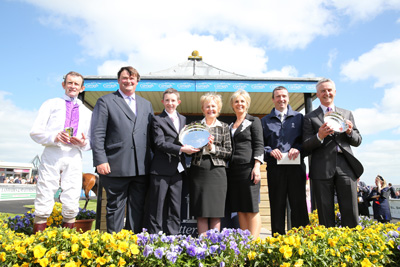 CURRAGH SUN 24 MAY 2015  PICTURE: CAROLINE NORRIS     TODD WATT PRESENTING THE TROPHIES FOR THE TATTERSALLS IRISH 1,000 GUINEAS WON BY PLEASCACH TO KEVIN MANNING, JAMES MANNING, JACKIE BOLGER, UNA MANNING, PAT O'DONOVAN AND JIM BOLGER.