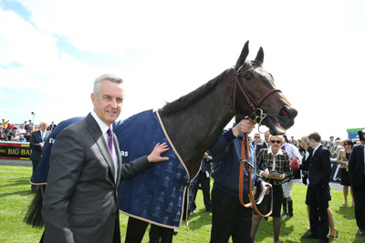 CURRAGH SUN 24 MAY 2015  PICTURE: CAROLINE NORRIS     PLEASCACH WITH JIM BOLGER AFTER WINNING THE TATTERSALLS IRISH 1,000 GUINEAS