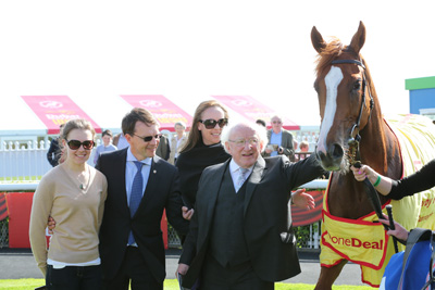 CURRAGH FRI 26 JUNE 2015  PICTURE: CAROLINE NORRIS     PRESIDENT HIGGINS STEPS INTO THE PICTURE WITH ANA, AIDAN AND ANNE MARIE O'BRIEN AFTER ALICE SPRINGS HAD WON THE WHEN YOU WANT IT DONE, DONE DEAL EBF FILLIES MAIDEN