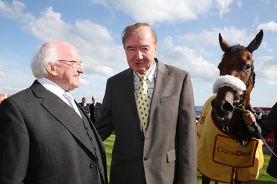 CURRAGH FRI 26 JUNE 2015  PICTURE: CAROLINE NORRIS     PRESIDENT HIGGINS WITH DERMOT WELD AFTER HIS HORSE AIMHIRGIN LASS HAD FINISHED SECOND TO THE WELD TRAINED ESHERA IN THE SECOND RACE.