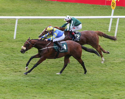 CURRAGH SAT 27 JUNE 2015  PICTURE: CAROLINE NORRIS     HASANOUR RIDDEN BY SHANE FOLEY GETTING UP TO WIN THE PADDY POWER HANDICAP FROM BREATHE EASY RIDDEN BY LEIGH ROCHE, FAR SIDE, 2ND.