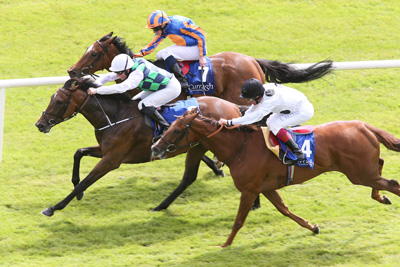 CURRAGH SUN 28 JUNE 2015  PICTURE: CAROLINE NORRIS     DIAMONDS AND RUBIES RIDDEN BY SEAMUS HEFFERNAN WINNING THE SEA THE STARS PRETTY POLLY STAKES FROM LEGATISSIMO RIDDEN BY RYAN MOORE, 2ND, FAR SIDE, AND RIBBONS RIDDEN BY FRANKIE DETTORI, NEAR CAMERA, 3RD