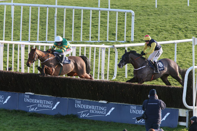 FAIRYHOUSE SUN 10 JANUARY 2016  PICTURE: CAROLINE NORRIS   NEARLY NAMA'D RIDDEN BY BARRY GERAGHTY JUMPING THE LAST FENCE TO WIN  THE UNDERWRITING EXCHANGE DAN MOORE MEMORIAL HANDICAP STEEPLECHASE FROM GUITAR PETE RIDDEN BY NINA CARBERRY, 3RD