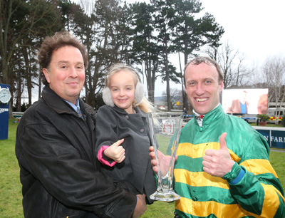 LEOPARDSTOWN SUN 17 JANUARY 2016  PICTURE: CAROLINE NORRIS       CHARLES O'BRIEN, TRAINER OF THE WINNER HENRY HIGGINS, WITH HIS DAUGHTER EMILY, WINNING JOCKEY ROBERT POWER AND THE TROPHY FOR THE CORAL.IE HURDLE