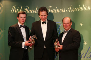 The IRTA Champions Dinner, Hotel Keadeen Sun 7 May 2017 Picture: Caroline Norris Tim Smalley, MD Bedmax, presenting Joseph O'Brien and Michael Halford, Joint Champion Trainers of Winter Series Dundalk 2016/17, with their awards.